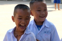 Two  cute boys playing with springrope at the orphanage - Innburi - Esmeralda Groen
